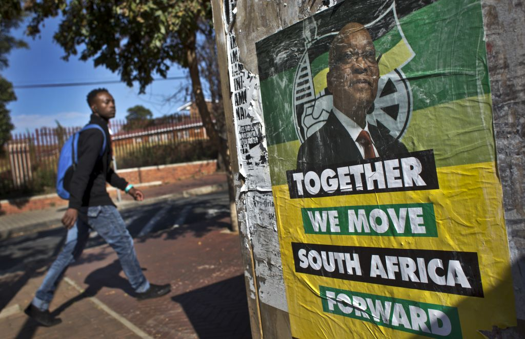 A man walks past an election poster of Jacob Zuma's African National Congress (ANC) party in the Soweto township of Johannesburg, South Africa Friday, May 9, 2014. (photo credit: AP/Ben Curtis)