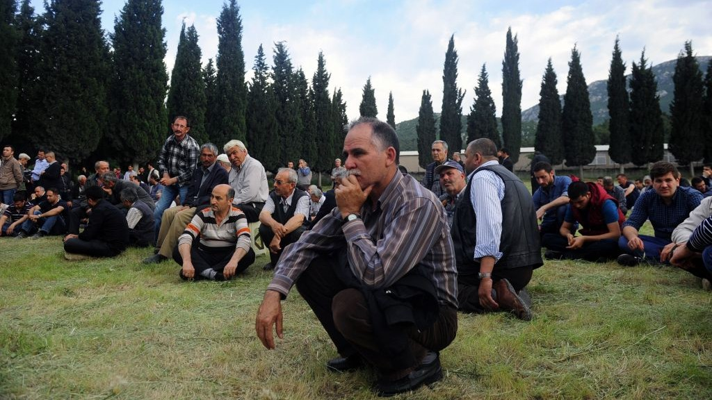 People attend a mine accident victim's burial in Soma, Turkey, on Wednesday photo credit: AP/Emre Tazegul)