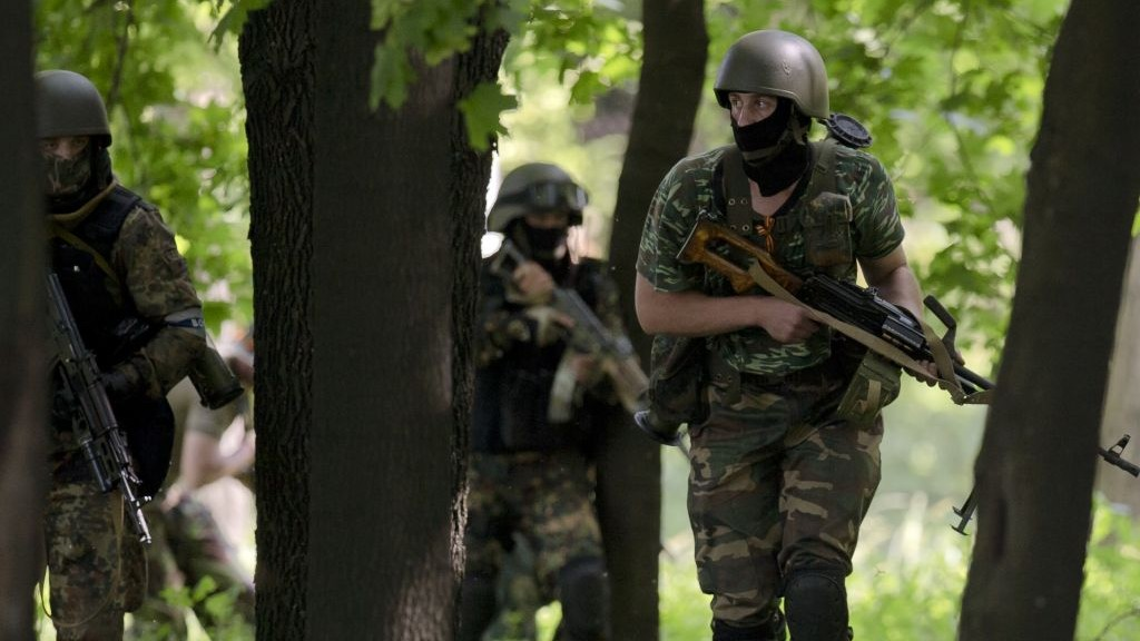 Pro-Russian gunmen take positions near an airport outside Donetsk, Ukraine, on Monday, May 26, 2014 (photo credit: AP Photo/Vadim Ghirda)