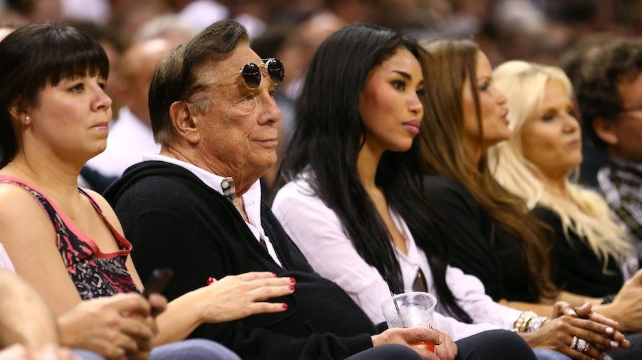Los Angeles Clippers owner Donald Sterling is pictured here with V. Stiviano to his left at a 2013 basketball game. (photo credit: Ronald Martinez/Getty Images/JTA)