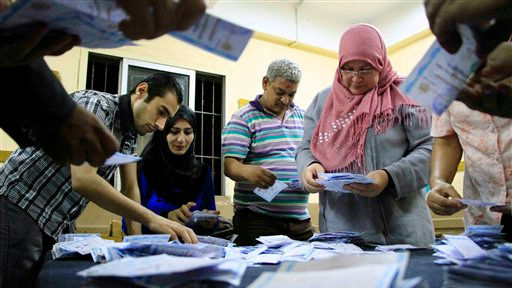 Election workers count ballots at a counting center in Cairo, Wednesday, May 28, 2014 (photo credit: AP /Lobna Tarek, El Shorouk Newspaper)
