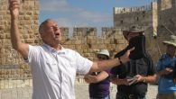 Bart Repko leads Christian pilgrims through the ramparts of the Old City walls.  Steve Lipman/JW
