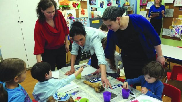 Rhonda Rose, left, at work in her twin sons' pre-K class at Beit Rabban. Michael Daitikash/JW