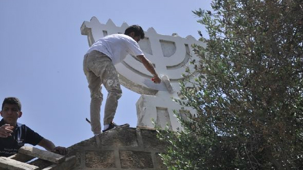 Young residents of Shfaram repair the town's ancient synagogue, in what residents say is a response to the 'price tag' attacks of Jewish extremists in the region. (photo credit: Courtesy of Shfaram Municipality)