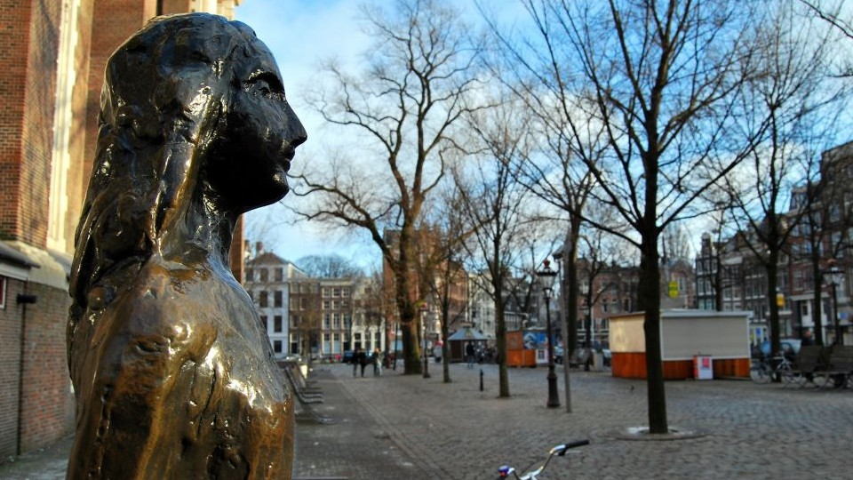 Anne Frank Statue, Amsterdam, The Netherlands, Holland. (Photo credit: Anne Frank statue image via Shuttershock)