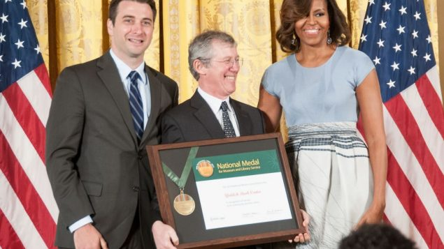 Peter Manseau, Aaron Lansky and Michelle Obama at the White House. Courtesy Institute of Museum and Library Services