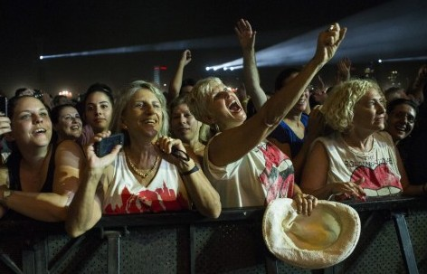 Fans cheer as The Rolling Stones perform on stage at Hayarkon Park in the Mediterranean coastal city of Tel Aviv, on June 4, 2014. (Photo credit: AFP PHOTO / JACK GUEZ)