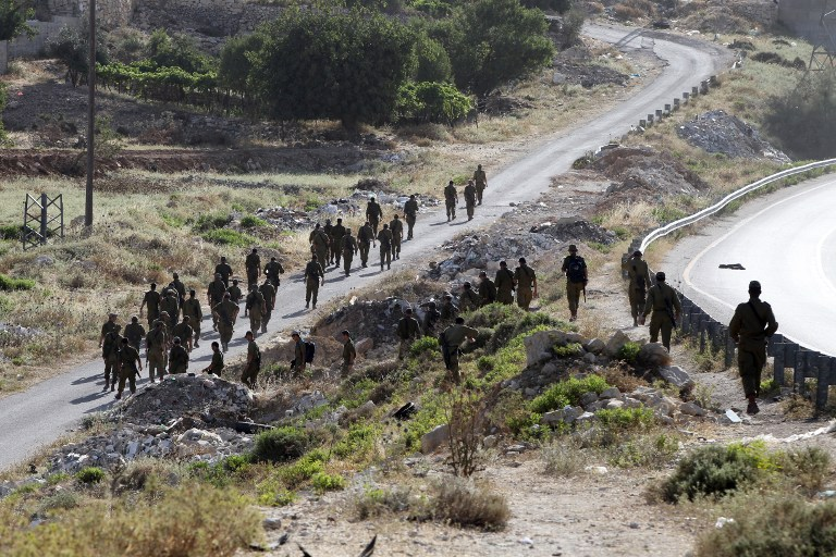 Israeli soldiers begin a search operation in the village of Halhul, near the West Bank town of Hebron, on June 29, 2014. (photo credit: AFP/HAZEM BADER)