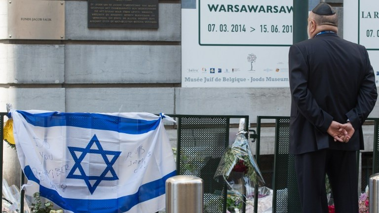 A man takes part in a solidarity ceremony of the World Jewish Congress after the killings at the Jewish museum in Brussels on June 2, 2014. photo credit: AFP/ BELGA / BENOIT DOPPAGNE)