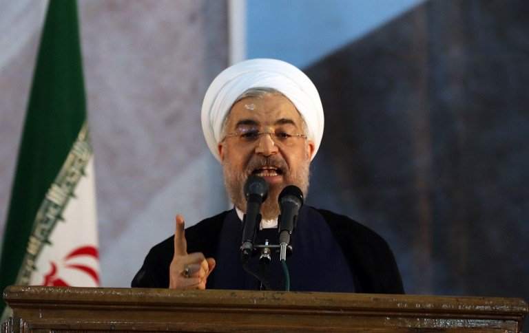 Iranian President Hassan Rouhani delivers a speech at a memorial ceremony in Tehran, June 3, 2014. (photo credit: AFP/ATTA KENARE)