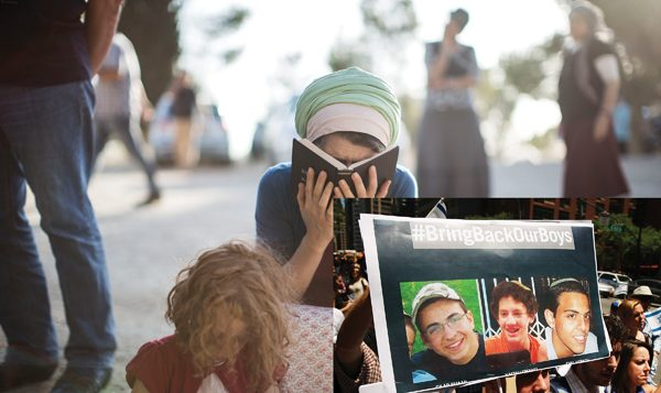 A woman in the West Bank town of Gvaot takes part in prayer for three kidnapped yeshiva students. Getty Images