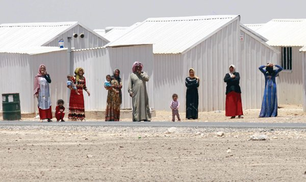 Refugees, gather next to a road at the Azraq refugee camp. Getty Images