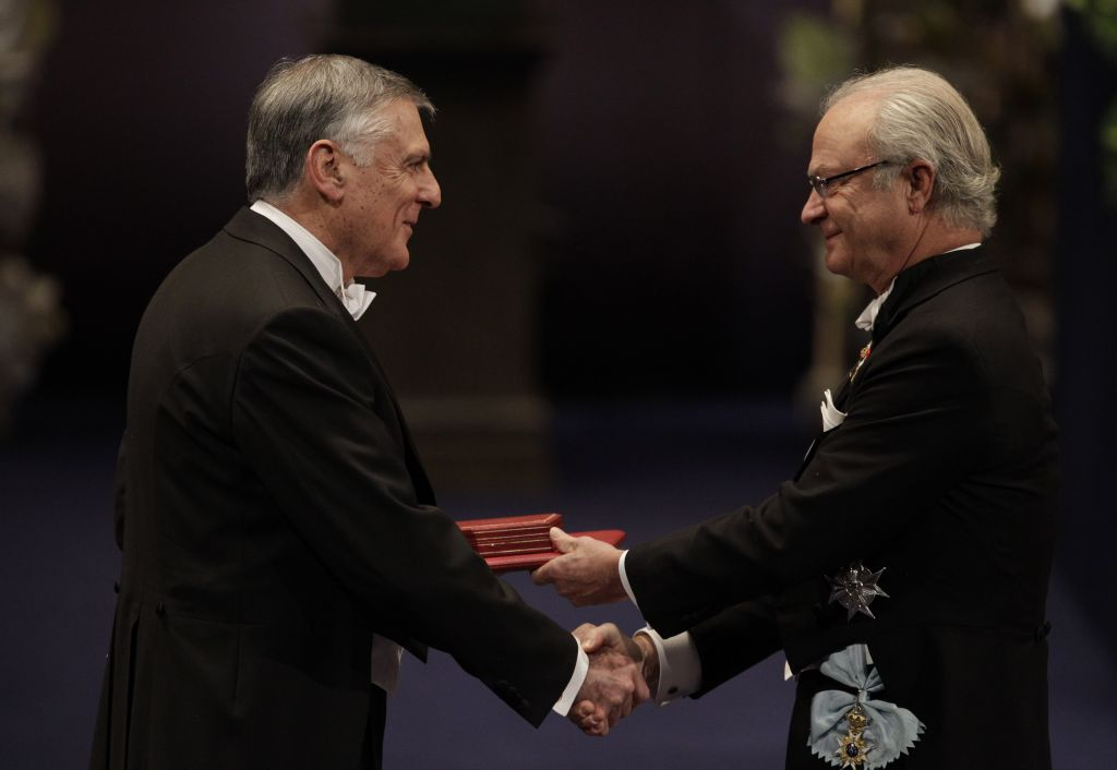 The 2011 Nobel Prize Laureate for Chemistry, Professor Dan Shechtman from Israel, receives his Nobel Prize from Sweden's King Carl XVI Gustaf, right, during the Nobel Prize award ceremony at the Stockholm Concert Hall in Stockholm, Saturday, Dec. 10, 2011. (photo credit: AP Photo/Matt Dunham)