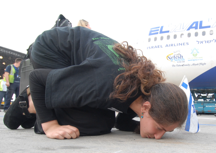 A Jewish new immigrant kisses the ground after arriving Israel, 2006 (photo credit Guy Assayag /Flash90)