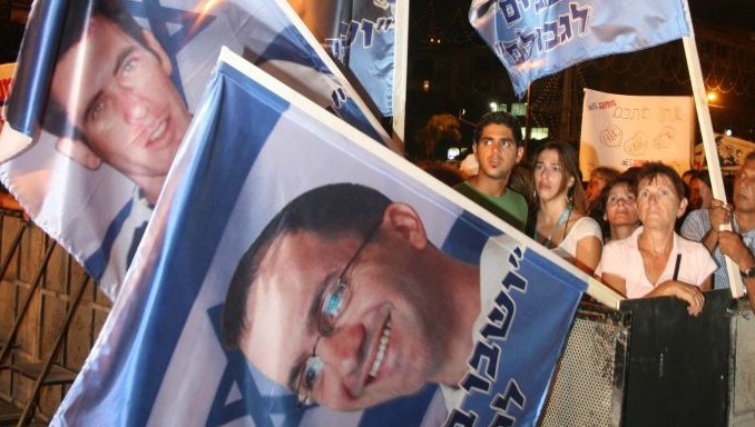 Tens of thousands of Israelis attend a 2006 rally in Tel Aviv for soldiers Ehud Goldwasser and Eldad Regev. (photo credit: Flash90)