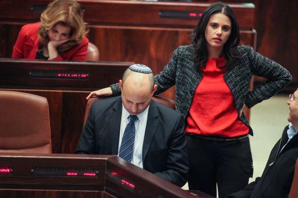 Jewish Home party leader Naftali Bennett and MK Ayelet Shaked attend a plenum session in the Knesset on March 12, 2014. (photo credit: Flash90)