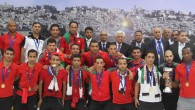 The Palestinian national soccer team along with PA President Mahmoud Abbas after winning the AFC Challenge Cup in late May (photo credit: Issam Rimawi/ Flash 90)
