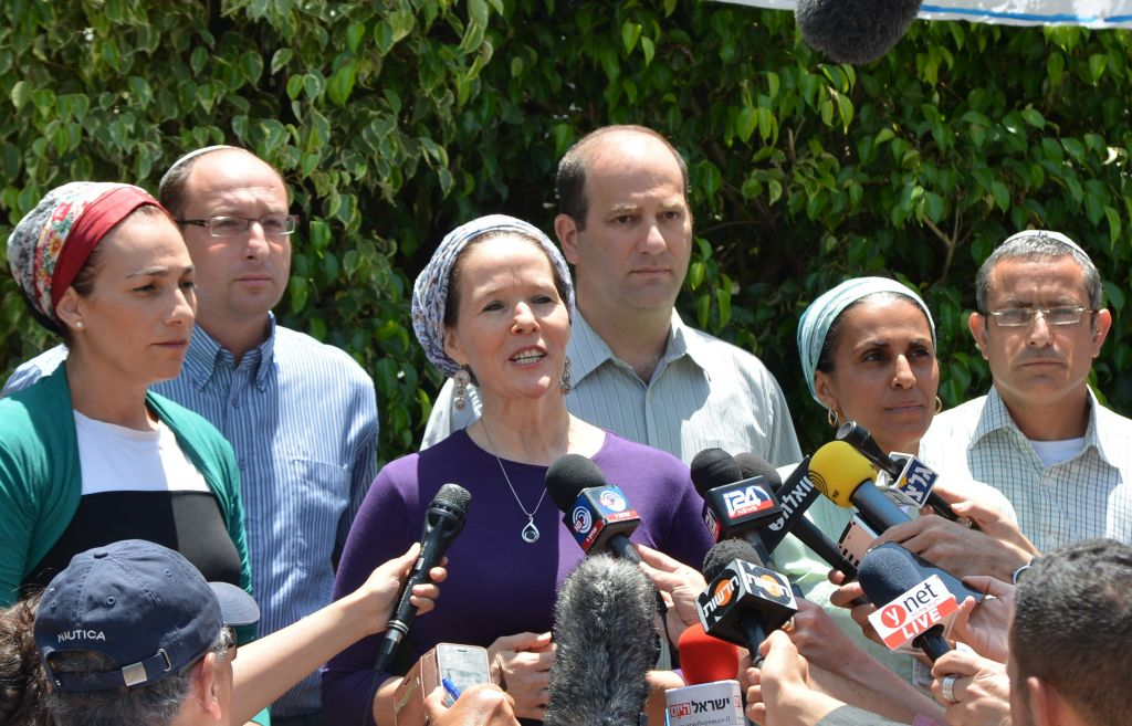 Racheli Sprecher Frankel, mother of kidnapped Israeli youth Naftali, speaks to the press outside her house on Tuesday, June 16, 2014. She is flanked by the parents of two other teens kidnapped with her son, Gil-ad Shaar and Eyal Yifrach. (photo credit: Yossi Zeliger/Flash90)