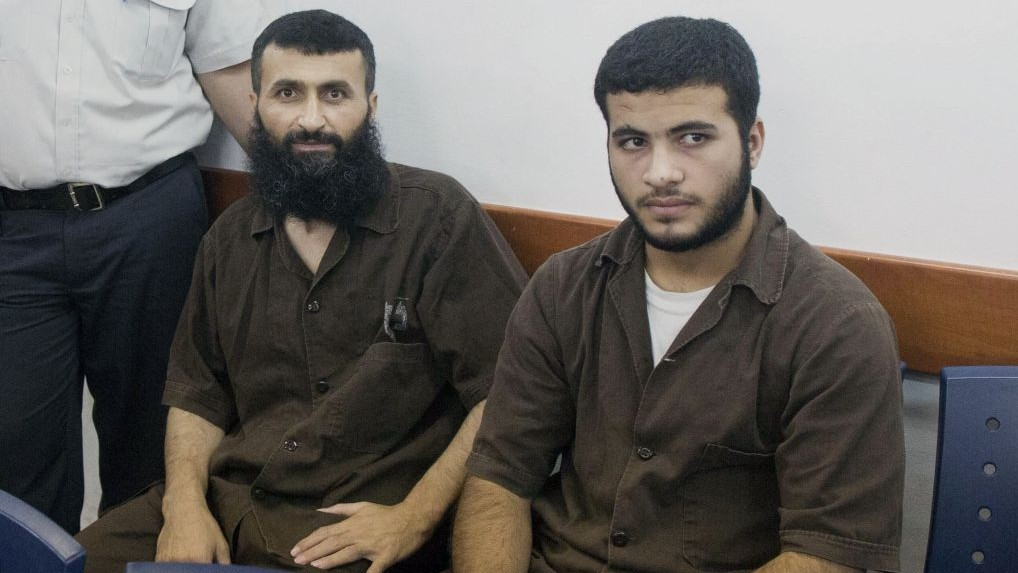 Ziad Awad (L) and his son Izz Eddin (R) at Ofer Military court on June 23, 2014. The two were arrested on May 7 for the April 14 shooting of Baruch Mizrahi (Photo credit: Yonatan Sindel/Flash90)