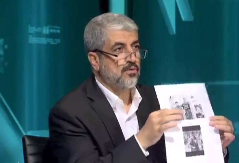 Hamas political bureau chief Khaled Mashaal displays a page purporting to prove that the kidnapped Israeli teenagers were soldiers, June 23, 2014 (photo credit: YouTube image)