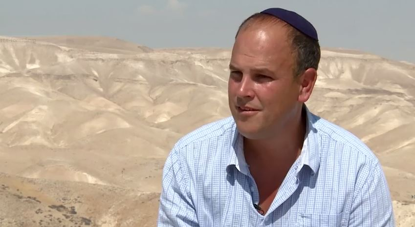 Dr. Micah Goodman on the grounds of the Ein Prat Midrasha in Alon. (YouTube screenshot)
