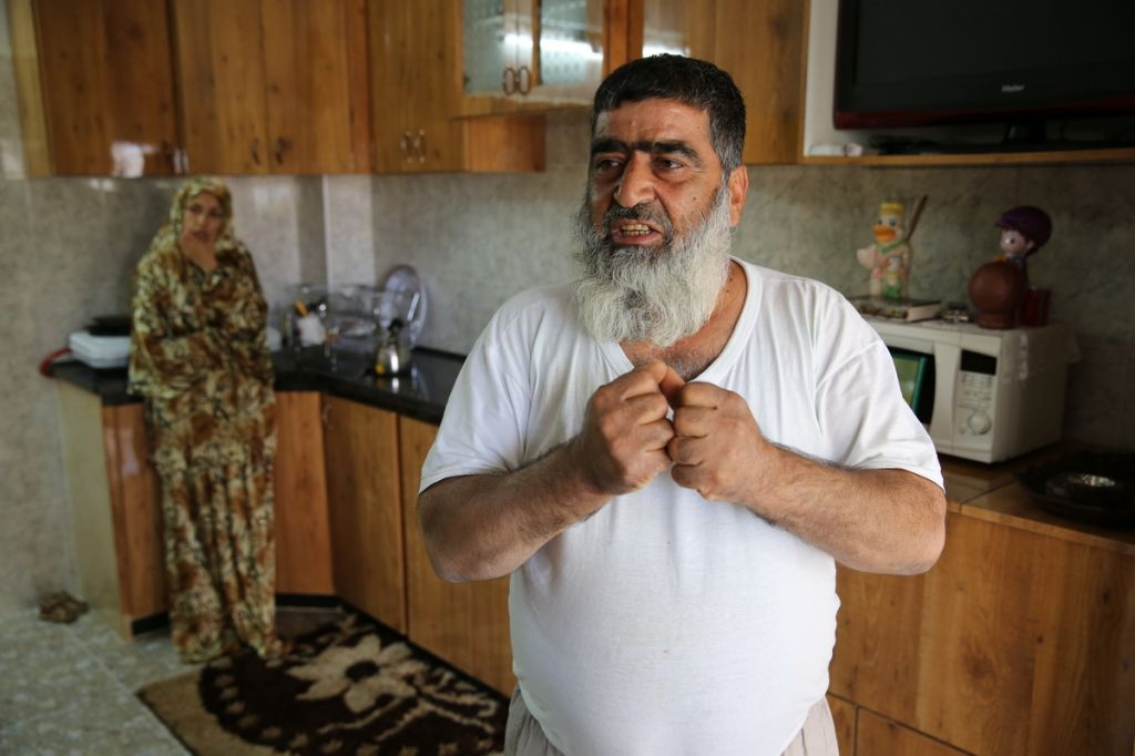 Omar Abu Aysha, father of suspected kidnapper Amer Abu Aysha, in his home in Hebron (photo credit: Ziv Koren)