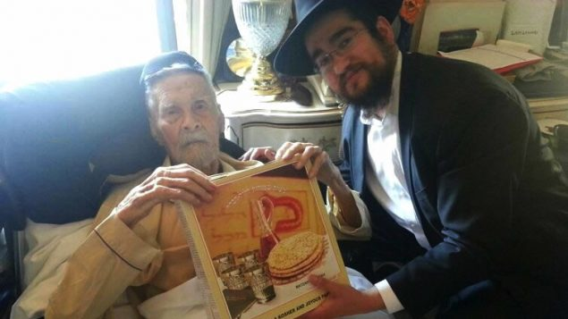 Alexander Imich, seen here with Rabbi Pinny Marozov in April, just before Passover, died this week. Courtesy of Chabad.org