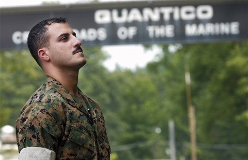 In this July 19, 2004 file photo USMC Cpl. Wassef Ali Hassoun prepares himself as he waits to make a statement to a large crowd of media outside the gates to USMC Base Quantico, Va. (photo credit: AP Photo/Dylan Moore, File)