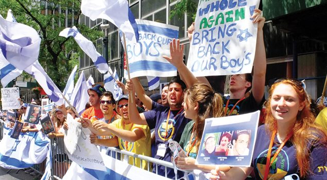 About 1,000 people turned out at a midtown rally to support three kidnapped Israeli students. Michael Datikash/JW