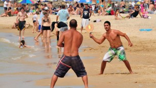 http://www.shutterstock.com/pic-138636812/stock-photo-ashkelon-apr-israeli-men-play-matkot-on-april-it-s-a-popular-paddle-ball-game-in.html?src=yFtHwD8DLRHb9CV1H_32LA-1-0