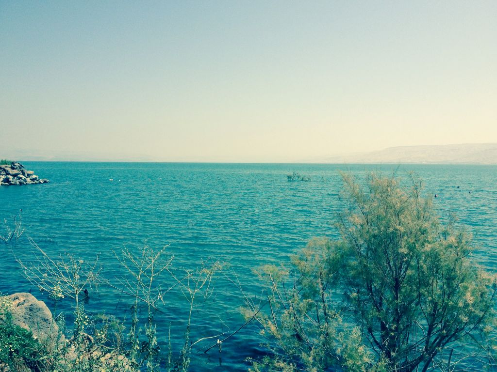 The sparkling blue waters of the Sea of Galilee, seen from the RV window (photo credit: Jessica Steinberg/Times of Israel)