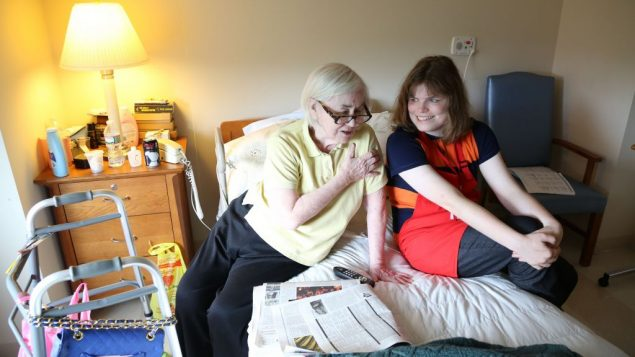 Haley McCormick-Thompson helps a resident. Courtesy of Rick Guidotti