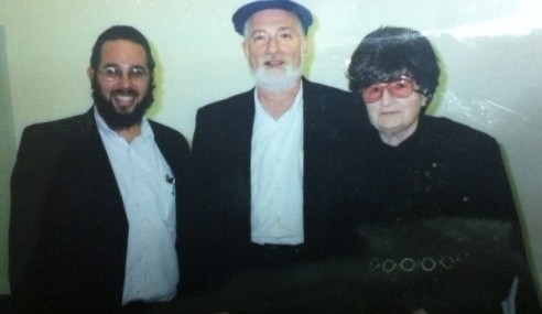 Better times: On a visit to Florida circa 2007, Yaakov Feldman, left, is shown with his wife's grandmother, Regina Ament, and her son, Markus.  (courtesy/JTA)