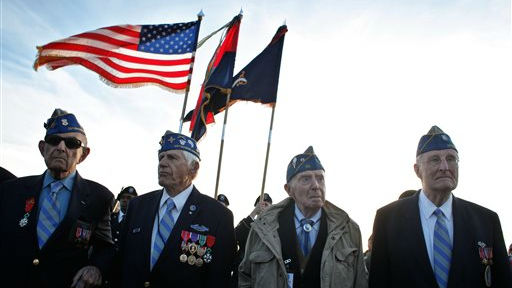 From left, World War II veterans of the U.S. 29th Infantry Division, Hal Baumgarten, 90 from Pennsylvania, Steve Melnikoff, 94, from Maryland, Don McCarthy, 90 from Rhode Island, and Morley Piper, 90, from Massachusetts, attend a D-Day commemoration, on Omaha Beach, western France , Friday June 6, 2014, (photo credit: AP/Thibault Camus)