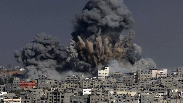 Heavy smoke billows following an Israeli military strike on Gaza City, on July 29, 2014. (photo credit: AFP/Ashraf Amra)