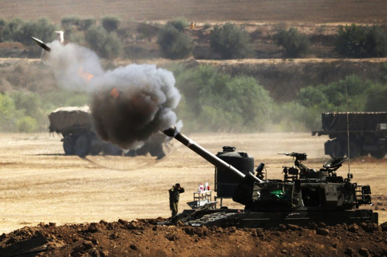 An Israeli artillery gun fires a 155mm shell towards targets from their position near Israel's border with the Gaza Strip on July 30, 2014. (photo credit: AFP/ JACK GUEZ)