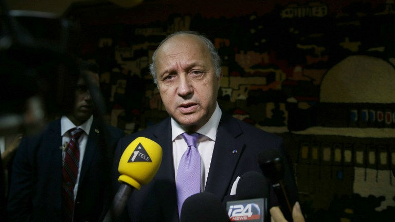 French Foreign Minister Laurent Fabius speaks to the press following his meeting with Israeli Prime Minister Benjamin Netanyahu, prior to his departure from Ben Gurion International Airport, near Tel Aviv, on July 19, 2014.  (photo credit: AFP/GALI TIBBON)