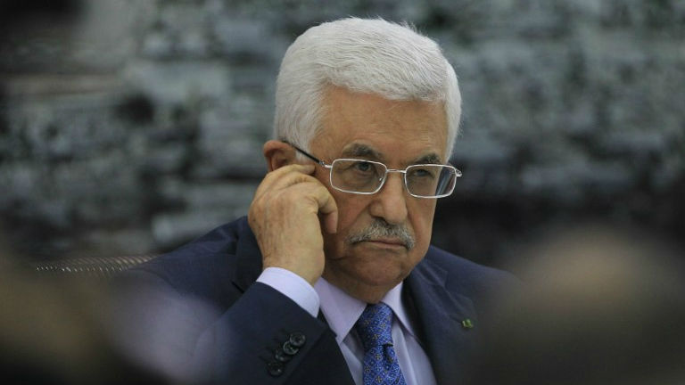 Palestinian Authority President Mahmoud Abbas looks on as he meets with members of the Palestine Liberation Organization (PLO) on July 22, 2014, in the West Bank city of Ramallah. (photo credit: AFP/ABBAS MOMANI)