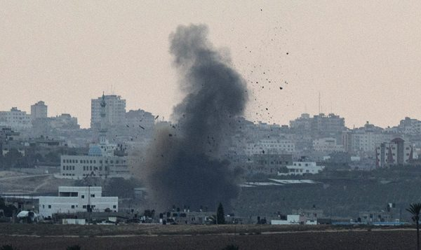 Smoke billows from the Gaza Strip Tuesday after an Israeli air strike. Getty Images