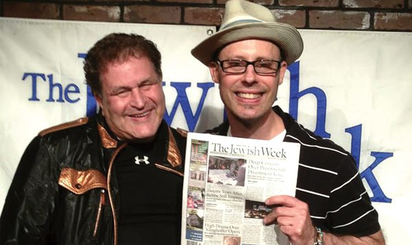 Funniest Jewish Comedian winner Howard Newman, left, and Geoff, who produces the annual event.