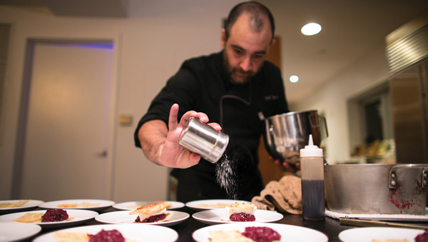 Chef Ygael Tresser prepares his Red Fruit Mille Feuille dessert.  Chana Blumes