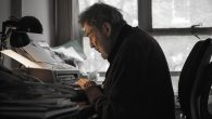 Hentoff at his desk. While at the Voice, he helped define the role of an alternative weekly.