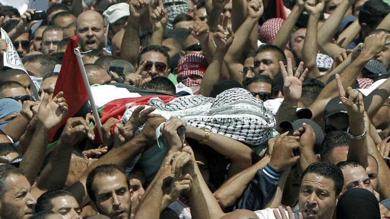 Relatives and friends of Mohammed Abu Khdeir, 16, carry his body to the mosque during his funerals in Shuafat, in israeli annexed East Jerusalem on July 4, 2014 (photo credit: AFP/ Thomas Coex)