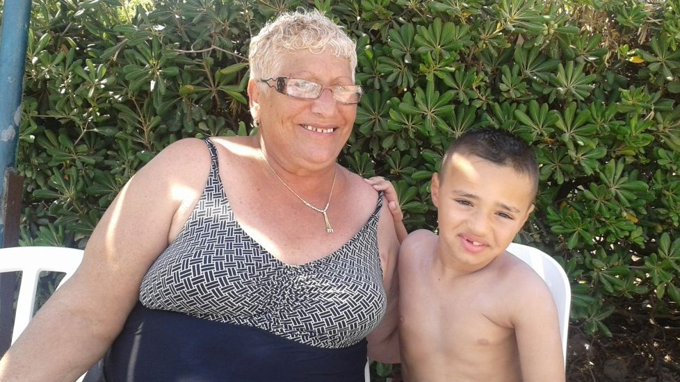 Jacqueline Ivgi and her grandson, Rom, on a OneFamily-sponsored vacation in Tiberias (photo credit: Simone Somekh)