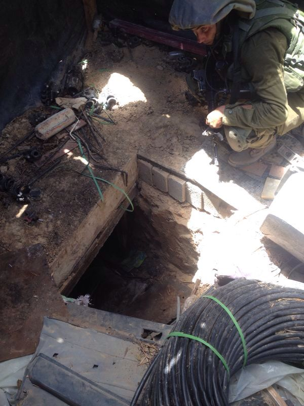 IDF soldiers stand outside the entrance to a Hamas tunnel on Friday, July 18, 2014. (photo credit: IDF Spokesperson)