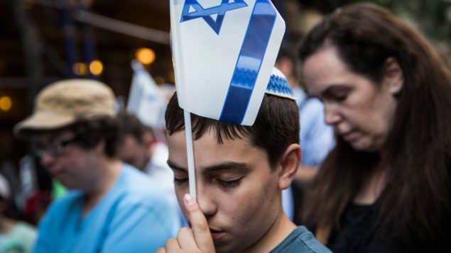 Aryeh Kalb, 13, attends a vigil in New York in remembrance of three Israeli boys who were kidnapped and murdered. Getty Images