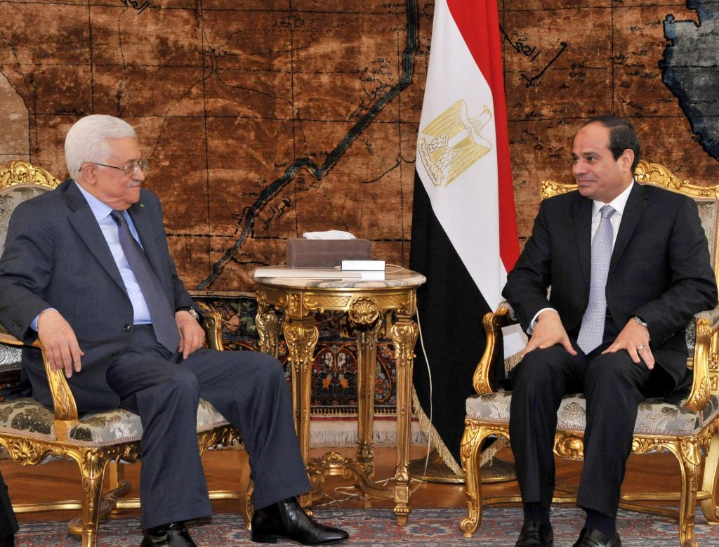Palestinian President Mahmoud Abbas, left, meets with Egyptian President Abdel-Fattah el-Sissi in Cairo, Egypt, Thursday, July 17, 2014 (photo credit: AP/MENA)
