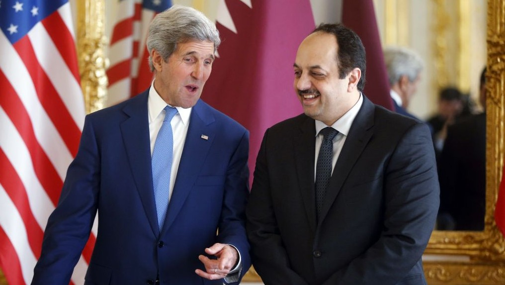 US Secretary of State John Kerry, left, talks with Qatari Foreign Minister Khaled al-Attiyah Saturday, July 26, 2014, at the US ambassador's residence in Paris (photo credit: AP/Charles Dharapak)