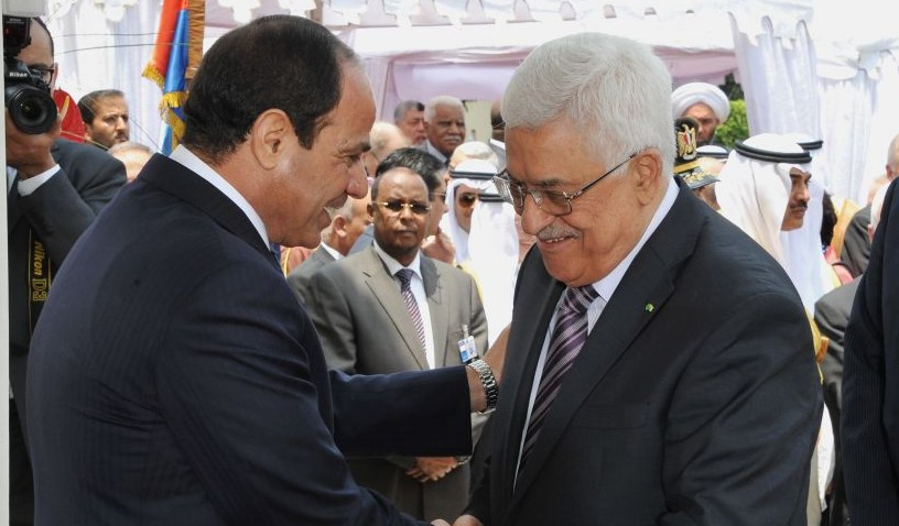 Egyptian President Abdel-Fattah el-Sissi, left, greets Palestinian Authority President Mahmoud Abbas during his inauguration ceremonies at the presidential palace in Cairo, Egypt, on June 8, 2014. (photo credit: AP/MENA)