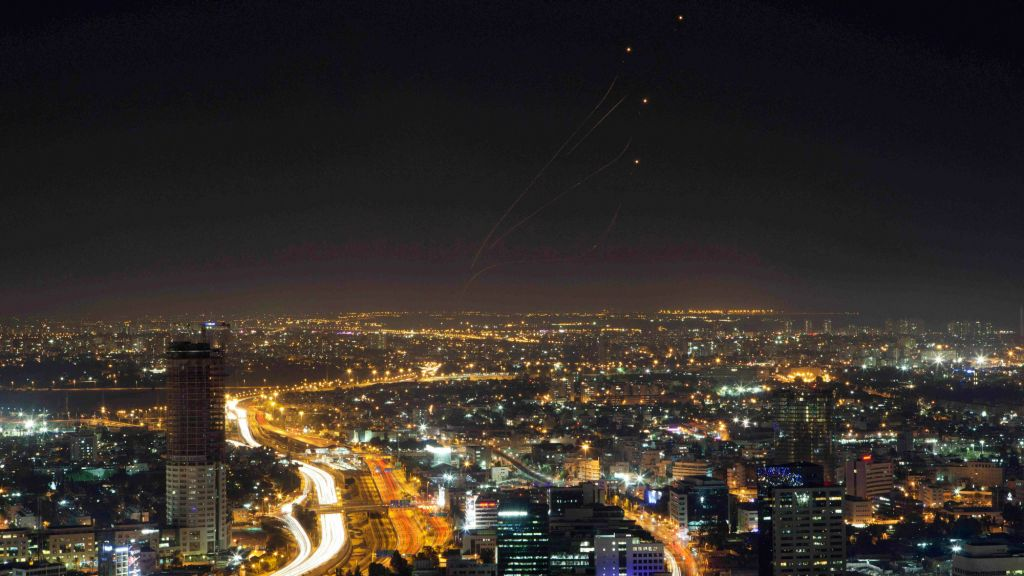 View of central Israel seen from Tel Aviv as an Iron Dome air defense system fires to intercept a rocket from the Gaza Strip, Israel, Thursday, July 10, 2014. (AP Photo/Dan Balilty)
